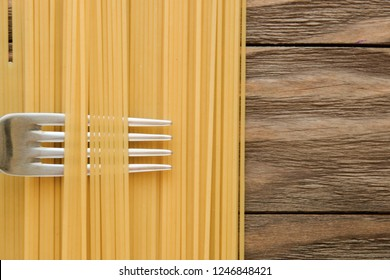 long spaghetti background. Yellow italian pasta. Long spaghetti. Raw spaghetti bolognese. Raw spaghetti. Food background concept