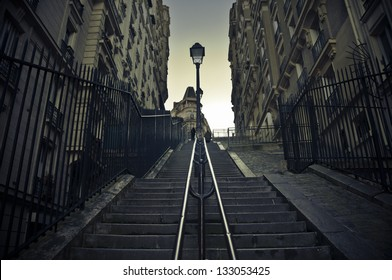 A long staircase in Montmartre (Paris, France) at dusk