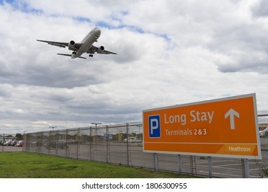 Long Stay Parking at Heathrow Airport with a plane flying above the car park. London - 31st August 2020