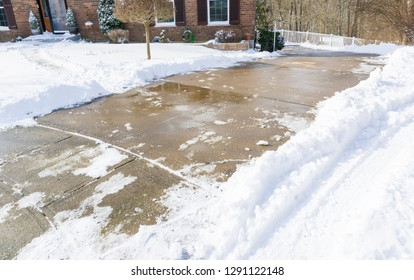 Long, steep, driveway in Kentucky after snow storm, all cleaned up with shoveling and salting.  Seasonal photography Weather