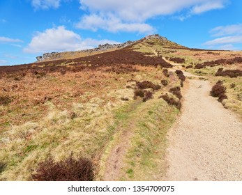 A long, steep footpath winds up to Higger Tor in the Derbyshire Peak District.