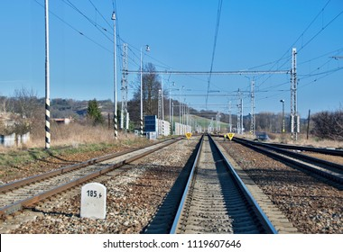 Long straight electrified railway line with some signals