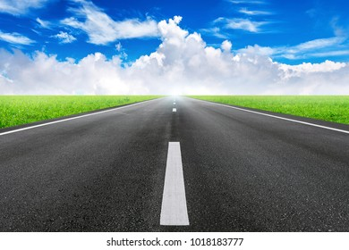 A long straight road and blue sky.