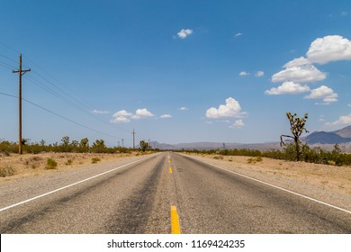 A long, straight road running through the Arizona desert