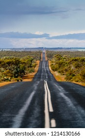 Long straight road through the West Australian wheatbelt leading into the distant horizon. Western Australia, Australia.