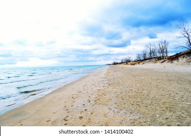 Long Stretch of Beach on a windy day at the expansive beaches of Sandbanks Provincial Park, Ontario, Canada