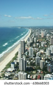 Long stretching golden sandy beach and modern skyscrapers at the beach front of Surfers Paradise in Gold Coast, Queensland, Australia