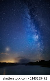 Long summer exposure, Milky Way, vertical panorama,  Devon, UK. Taken against trees on the horizon and a lake with Mars clearly visible