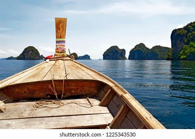 Long Tail boat among the islets of the Hong islands archipelago in the Phang Nga Bay