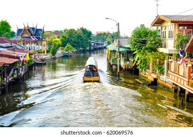 The long tail boat at Bangkok yai canal or Khlong Bang Luang Tourist Attraction with houses from local around water, Thailand