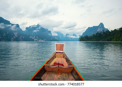 long tail boat and beautiful view in good morning time with Landscape of Rajjaprabha Dam, Khao Sok National Park, southern Thailand