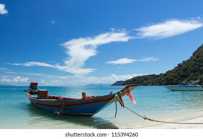 Long Tail Boat in Clear Water and Blue sky. Samui Island, Thailand.