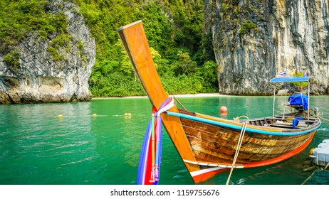 A long tail boat docking by the floating pier in Hong island beach, Krabi, Thailand.