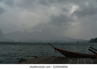 Long Tail boat Jungle view landscape of the Khao Sok National Park with jungle and Clouds and lake and sunrise rain forest
