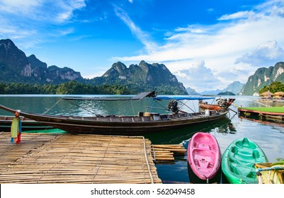 Long tail boat, a main transportation in Ratchaprapha Dam at Khao Sok National Park, Surat Thani Province, Thailand. Beautiful mountains and natural attractions. Kayaking, Recreation.