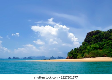Long tail boat mooring at Koh Nok near Koh Yao Noi in the Phang Nga Bay