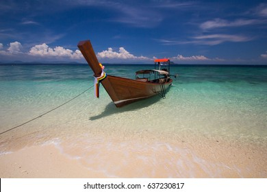 long tail boat with nice sky and beautiful beach at south of Thailand