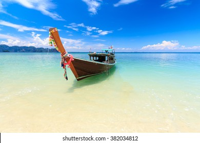 Long tail boat on tropical beach, poda island, Krabi, Thailand