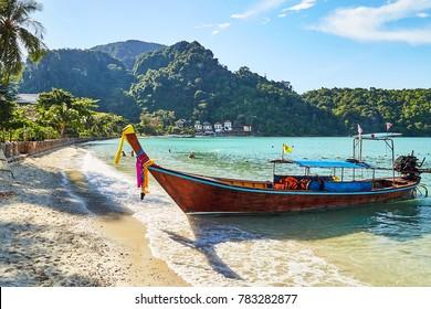 Long tail boat on tropical beach. Beach with palm trees. Railay Beach, Ao Nang, Krabi, Phuket, Thailand