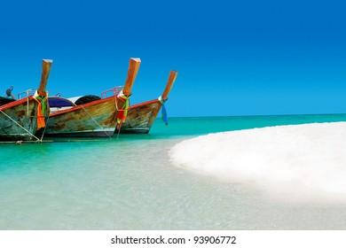 A long tail boat sits in phuket, Phuket, Thailand.