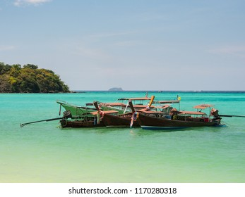 long tail boats with crystal clear water in sunny day at Phi Phi island, Thailand