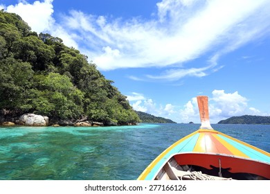Long tail boats  with crystal clear water, mountains and bright blue sky  at Koh Lipe(Lipe island), Satun, Thailand