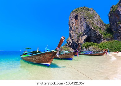 Long Tail Boats are getting ready to bring tourists to different island for swimming and snorkeling, Long tail boat at Railay Beach famous beach, Ao Nang, Krabi, Thailand.