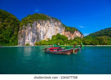 Long tail boats at koh Hong island, Kra bi Andaman sea of Thailand against beautiful clear blue sky.