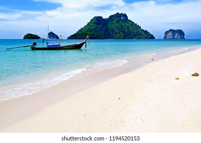 Long tail boats mooring at Koh Poda with Koh Tup, Koh Mor and Koh Kai in the background, in the Ao Nang bay, Krabi province, Thailand
