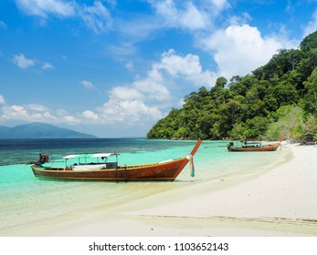 Long tail boats on the beach at Ko Lipe, Satun, Thailand