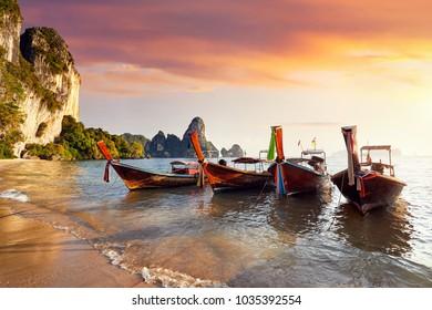 Long tail boats on tropical Tonsai beach at beautiful sunset in Krabi, Thailand