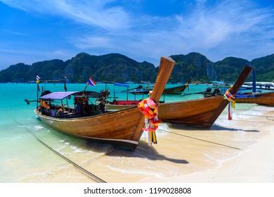 Long tail boats on tropical beach, Phi Phi Don island, Andaman sea, Krabi, Thailand