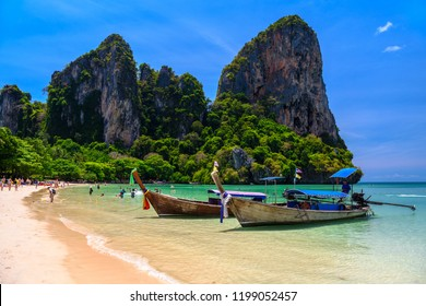 Long tail boats and rocks on Railay beach west, Ao Nang, Krabi, Thailand