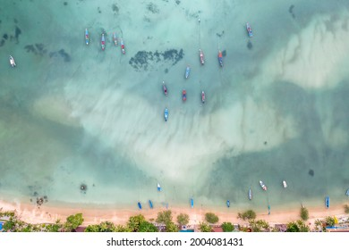 Long Tail Boats Tied Up In Shallow Water on Sairee Beach, Koh Tao, Thailand