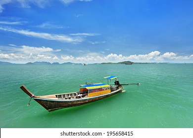 long tail taxi boat at Phuket  waiting tourist  visited  small island.The taxi boat is very importance for services the travellers