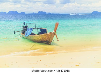 Long tailed boat at Kradan island, Thailand (Vintage filter effect used)