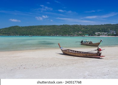 Long tailed boat on beautiful sand beach of Thailand