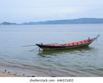 Long tailed boat. Parking on the sea beach with blue sky
