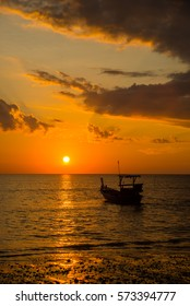 Long tailed boat at sunset