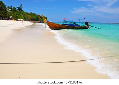 Long tale boat on colorful sea beach and blue sky at Phuket Thailand , beautiful beach, summer concept, sea and sand, traveling,wave