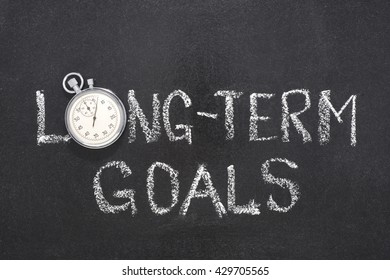 long term goals phrase handwritten on chalkboard with vintage precise stopwatch used instead of O