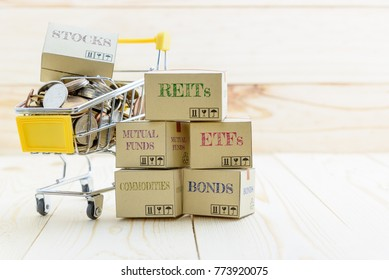 Long term sustainable and wealth management with risk diversification concept : Box printed with financial instrument / investment products i.e stocks, ETFs, bonds, REITs and coins in a shopping cart.