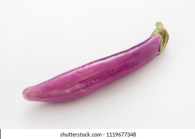 Long thin Light purple eggplant isolated white background
