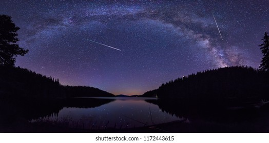 Long time exposure night landscape with Milky Way Galaxy during the Perseids flow above the Beglik dam in Rhodopi Mountains, Bulgaria