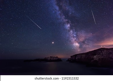 Long time exposure night landscape with planet Mars and Milky Way Galaxy during the Perseids flow above the Black sea, Bulgaria