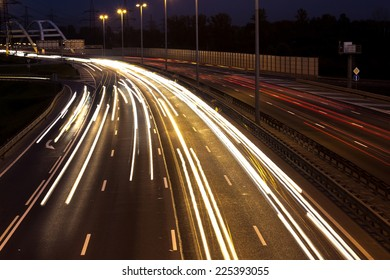 Long time exposure night scene of highway with long car lights trails in Saint-Petersburg, Russia.