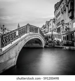 long time exposure of a typical venetian bridge over a canal, Venice, Italy, Europe, Black and white