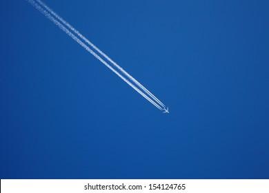 A long trail of jet plane on blue sky