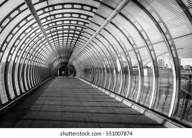 Long tunnel with two person walking down during sunset