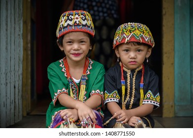 Long Tuyoq Village, East Borneo, Indonesia - October 23, 2017. Two female Dayak kids are dressed with Dayak traditional costumes in order to celebrate Hudoq Pekayang festival.